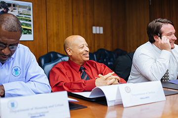 Cortez Puyear -DOJ VEPM (center) laughs it up with Dennis Hicklin-USAID VEPM (left) and Sean Lenahan-DOS VEPM (right)